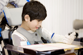 disabled five year old boy studying